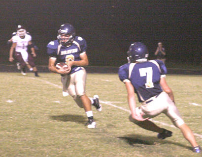 Blake Dills runs after intercepting a pass against Owen County Aug. 27.