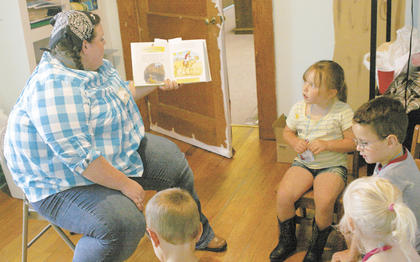 Rebecca Harrison reads about Joseph's coat of many colors to Ryan Knight, Charlese Daily C.J. Stine and Dani DeArment at Stewartsville Baptist Church on June 15.