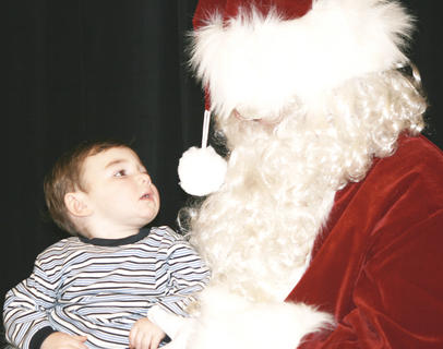 Brayden Webster, 15 months, studies Santa's face.