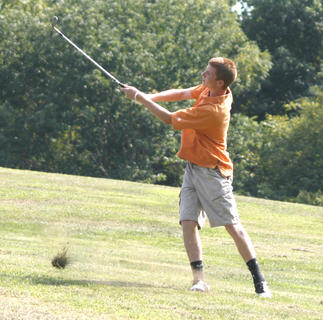 Williamstown senior Brian Barker chips a shot onto the green, during a match Aug. 18.