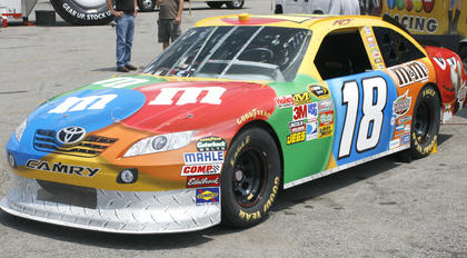 "A replica of the ""2011 Quaker State 400"" winner Kyle Busch's No. 18 car."