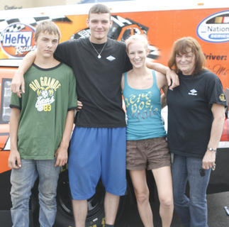Cameron Newcomb, Kevin McCullough, Amber Caldwell and Cindy Whitaker pose in front of car No. 14.