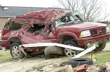 This SUV was mangled in the aftermath of the tornado that struck Crittenden and Piner.