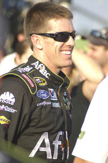 "Carl Edwards smiles before the inaugural ""Quaker State 400"" at Kentucky Speedway in Sparta."