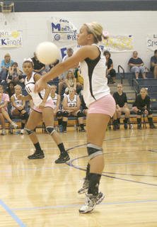 Lady Demons senior Carlie Fossitt hits the ball back over the net against Grant County Aug. 27.