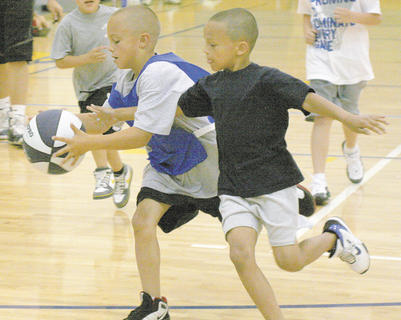 Isaiah Whalen, right, 7, of Crittenden tries to take the ball away from Carter Messerly, 7, of Crittenden in a scrimmage.