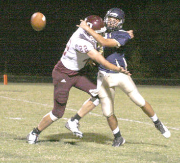 Braves quarterback Shelby Caudill gets hit hard after passing the ball forward.