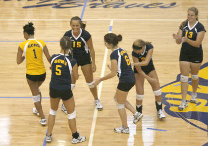 The Grant County Lady Braves celebrate after scoring a point against Bellevue Aug. 17.