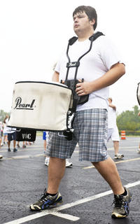 Charlie Wainscott beats on the drum in one formation.