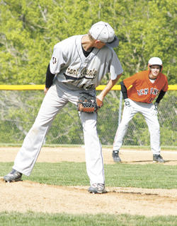 Braves senior pitcher Jordan Cummins checks Demons base runner Kevin McCullough during their game May 5.