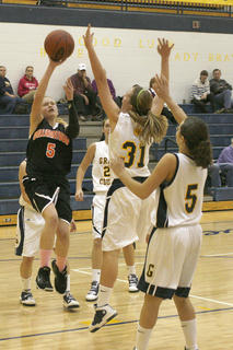 Seventh grader Katie Cheek shoots the ball against Grant County.