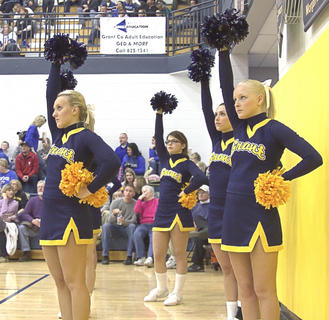 The cheerleaders get into formation for free throw shooting by the Braves.