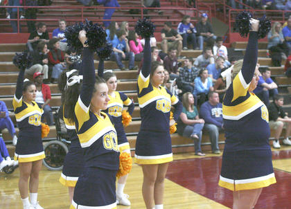 The Grant County High School cheerleaders get into formation, while the Braves go to the foul line for two shots.
