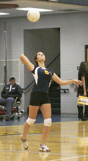 Lady Braves senior Chelsea Cason serves against Walton-Verona Sept. 15.