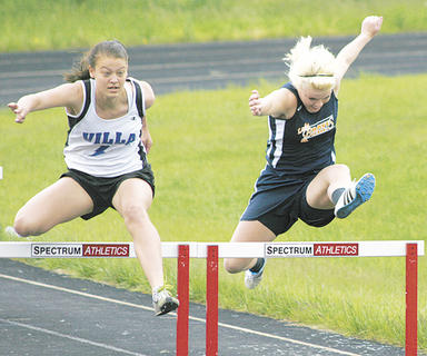 Lady Braves sophomore hurdler Cierra Fannon, right, competes in the 100 meter hurdles event May 7 at Grant County High School.