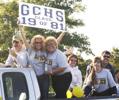Members of the Class of 1981 show they still have school spirit as they ride in the back of a truck.