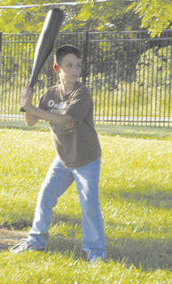 Cody Crittenden gets ready to hit a home run during the Backyard Game Night.