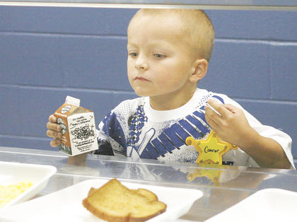 Connor Saylor scopes out what is for breakfast on the first day of school.