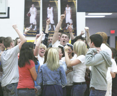 Students swarm the floor after Grant County upset Walton-Verona 55-50, Feb. 22.