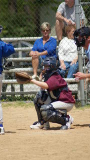 The catcher frames the pitch.