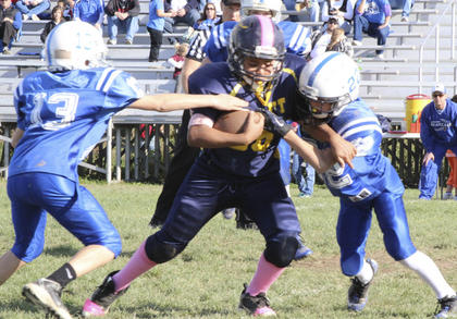 Damian Ingguls of the Blue Powerhouse tries to break free from a Walton-Verona player.