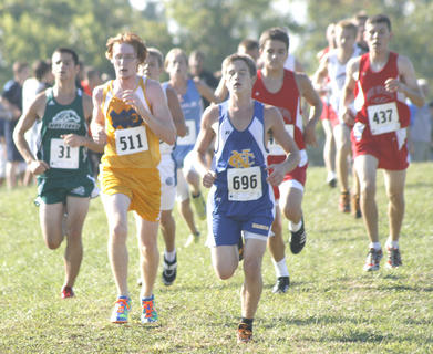 Braves senior Danny Hess runs in a big pack as they near the three-mile marker in the Grant County Invitational Sept. 10.