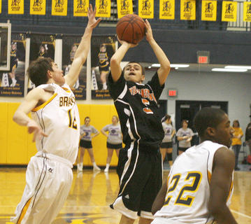 Demons sophomore guard David Jump shoots over the arm of Braves defender Austin Anglin. Jump scored 13 points to lead Williamstown.