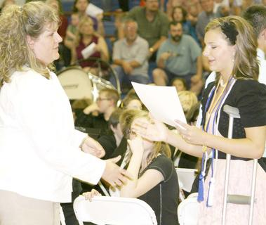 Bethany Lawrence gets her GCMS promotion diploma from Elizabeth Dalzell.