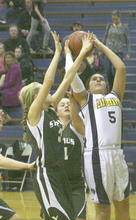 Eighth grader Destiny Chaidez muscles towards the basket against St. Pius Jan. 30.
