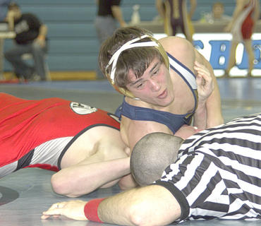 Freshman wrestler Devon Ingrassellino waits for the referee to make the call.