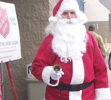 Dick Dildine dresses as Santa as he rings the bell for the Salvation Army outside of the Dry Ridge Wal-Mart.
