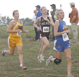 Braves cross country runner Elizabeth Robinson sprints towards the finish line at the Grant County Invitational Sept. 10.
