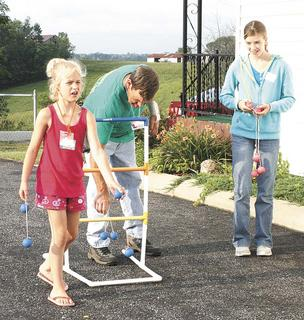 Above, Emillee Perkins and Holie Wilcoxen play a game at Stewartsville VBS.