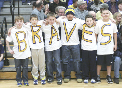 These young fans get into the spirit, sporting each letter of the school's nickname.
