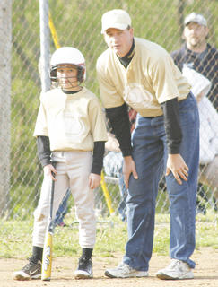 Mike Smith talks with his son Trent in the first inning.