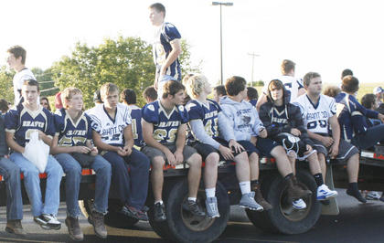 Members of the football team just enjoy the ride.