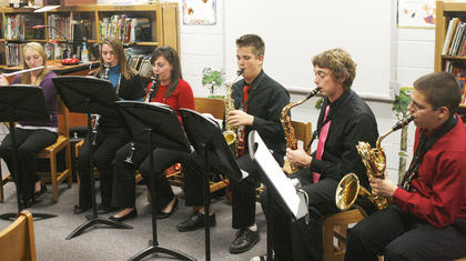 Members of the GCHS band perform at MCE Holiday Cafe.