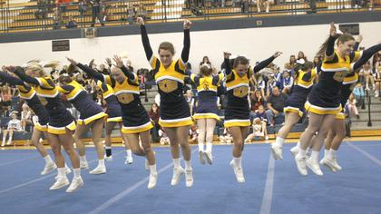 Grant County High School cheerleaders get ready to do their tumble.