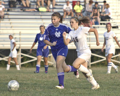 Lady Braves senior Emily Tillman fights for the ball against Walton-Verona.