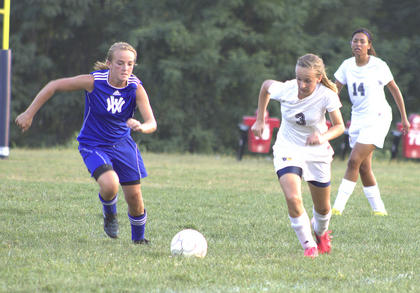 Lady Braves sophomore Emerald Fry chases down the ball against Walton-Verona.
