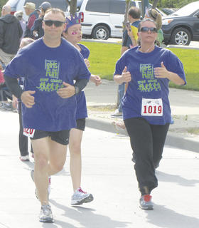 CMZ principal Heather Clay runs with her husband Doug during the 5K race in Cincinnati.