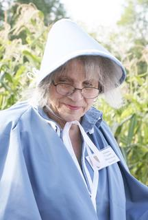 Georgia Dahlberg, a member of the Grant County Historical Society, dresses in costume and serves food.
