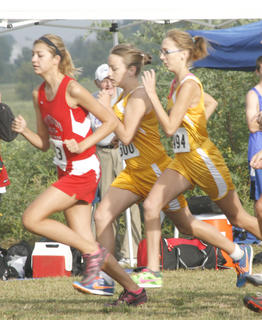 Kaitlyn Howard and Elizabeth Robinson work towards the front of the pack at the beginning of the race of the Grant County Invitational Sept. 10 at Sherman Elementary.