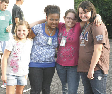 Sarah Franks, Taysia Perry, Danielle Roeteker and Sara Knight make friends at Stewartsville VBS.