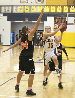 Hankinson tries to avoid the block from Lady Demons defender Morgan Potter.