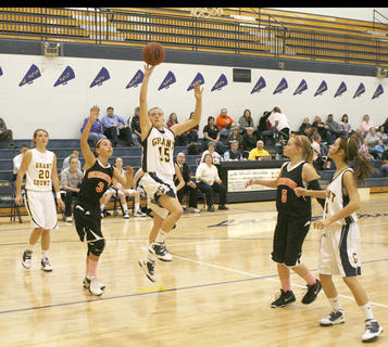 Freshman Emmalie Hankinson drives the lane against Lady Demons.
