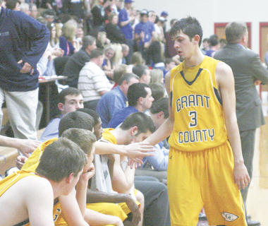 Andrew Hurley walks off the floor for the final time in his high school basketball career.