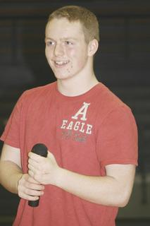 Ethan Workman smiles after a solid performance; he took first place singing solo.