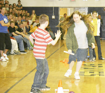 Grant County Middle School held a pep rally to rev up enthusiasm for Kentucky Core Content testing on April 15.  Students took tests April 18-19. Aaron Mischke is ready for the hand-off from Autumn Ellis in a relay against teachers.