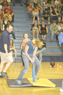 Patrick Burke watches as Madisyn Ruebusch spins for the students team.